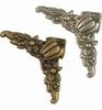 Hoeken  4x Antique Brass & 4x Silver   per setje