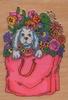 Hondje in tas met bloemen